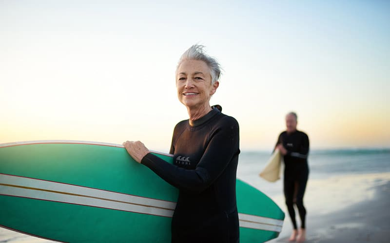 woman surfing after recovery with sedation dentistry miami