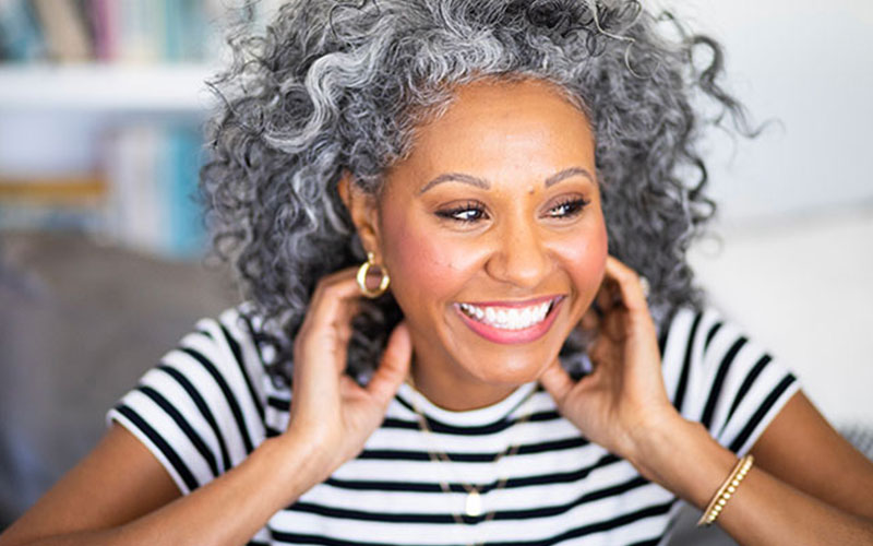 woman happy with her dental implants south miami