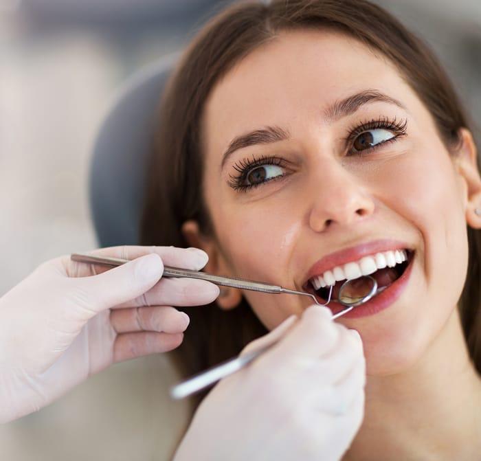 patient getting dental crowns in boca raton